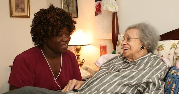 Nurse with patient in home setting